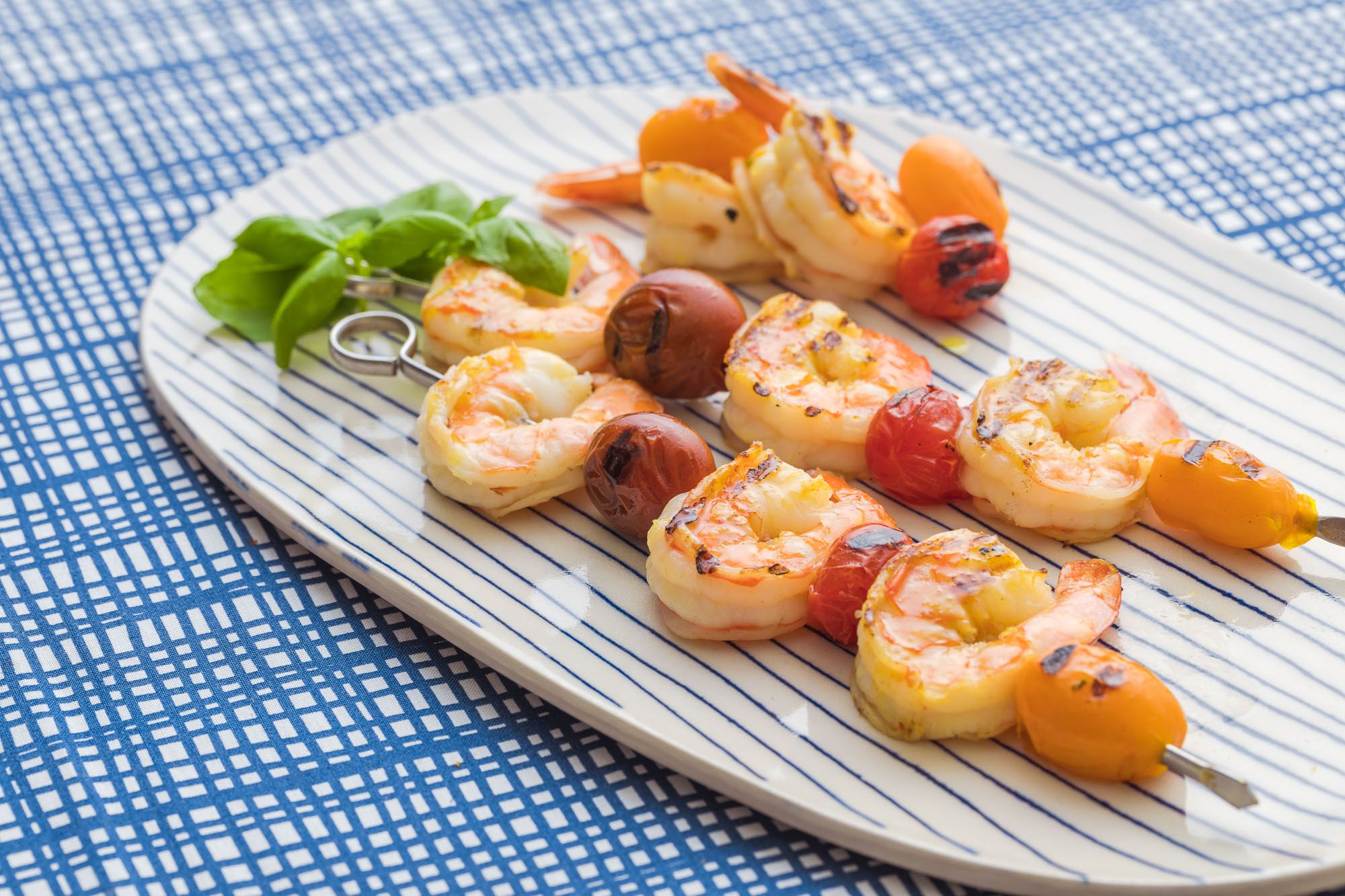 Cooking recipes: grilled-shrimp-skewers cooked with Bertolli olive oil. Extra Virgin Olive Oil.