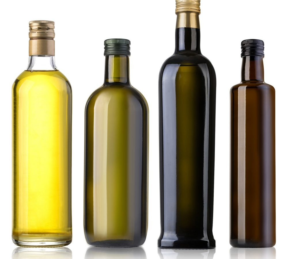 Four olive oil bottle in different colours representing olive oil quality and types. Bertolli Olive Oil.