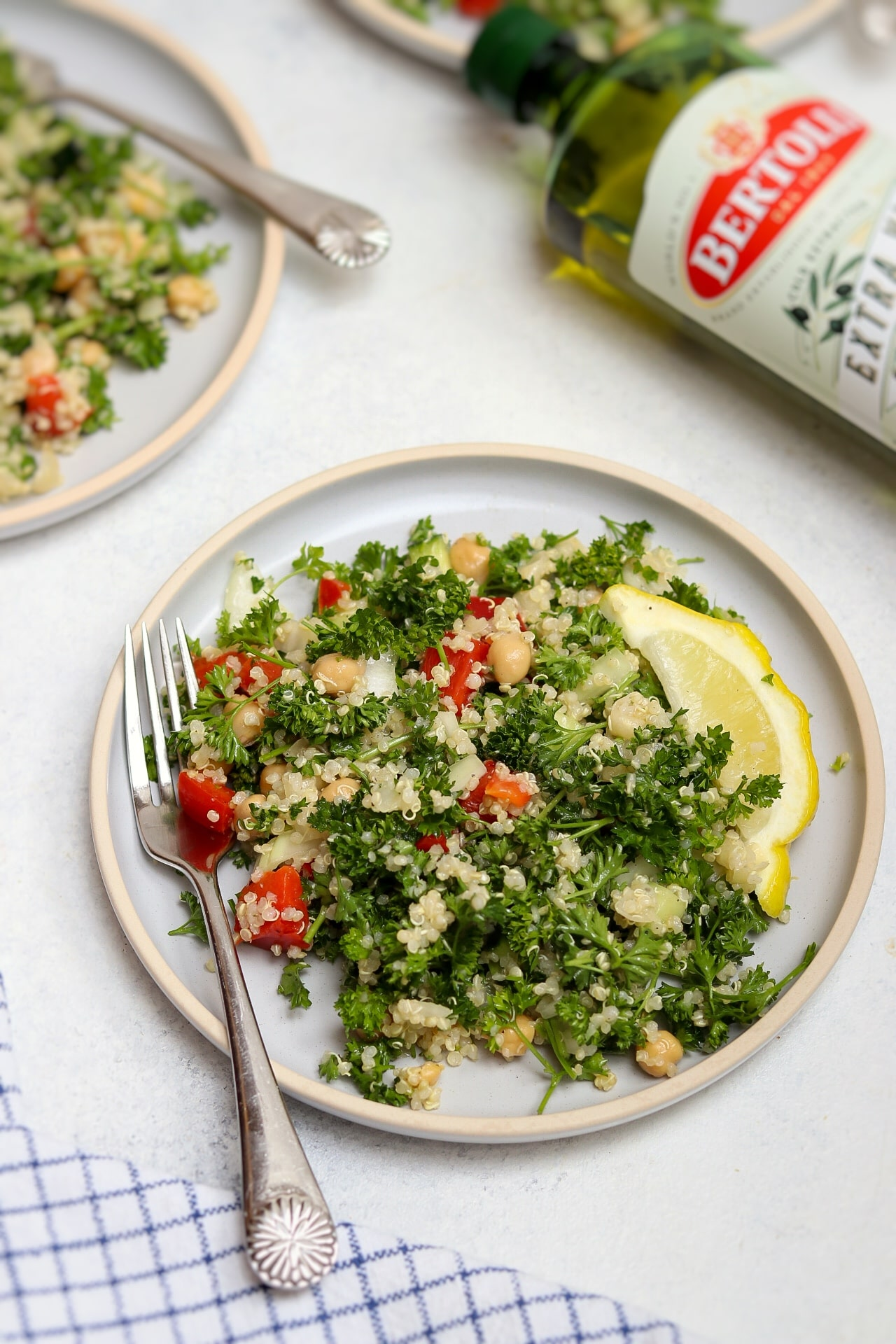 Quinoa Tabbouleh Salad represents Bertolli quality olive oil.